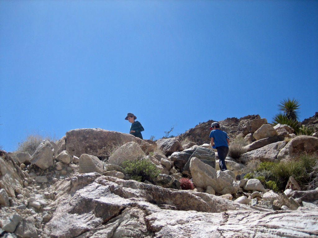 On Sunday morning the boys climbed the steep rock face above camp